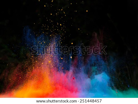 Launched colorful powder, isolated on black background Royalty-Free Stock Photo #251448457