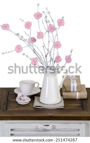 origami flowers on the white branches in a jar on vintage nightstand #251474287