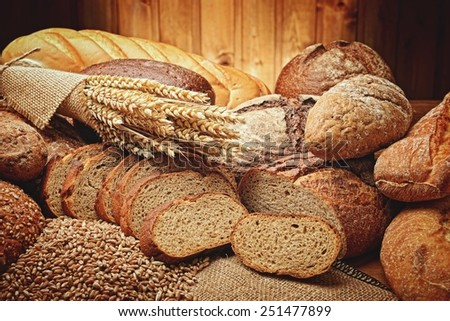fresh bread and wheat on the wooden #251477899