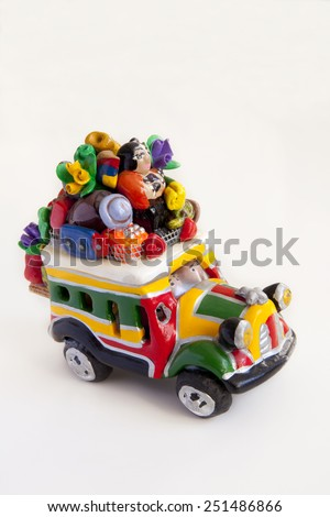 Handicraft representing a typical bus from Colombia, known as �chiva�. Colombian handicrafts bus.  #251486866
