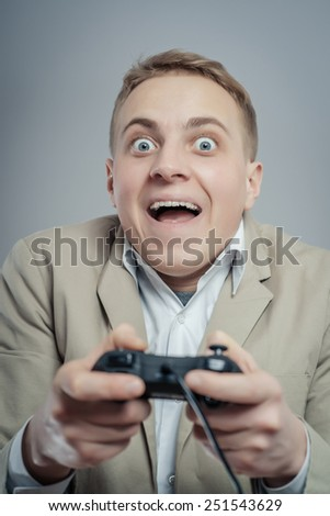 Emotional office clerk games with joystick on a gray background #251543629
