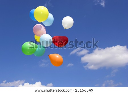 Bunch of party balloons against sky #25156549