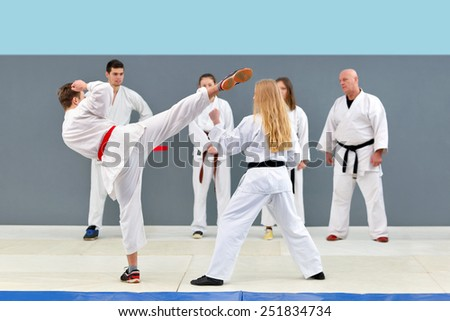 The old karate master martial procedure shows a group of young, beautiful and successful fighters #251834734