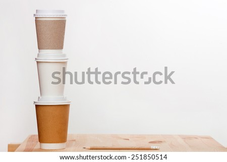 Disposable coffee cups on wooden table. #251850514