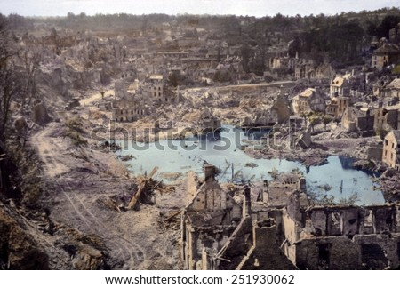 We sure liberated the hell out of this place', remarked a U.S. soldier. Saint Lo, France was 95% destroyed before it was captured from Germans on July 18, 1944. B&W Photo with oil color. Royalty-Free Stock Photo #251930062