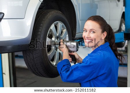Mechanic adjusting the tire wheel at the repair garage #252011182