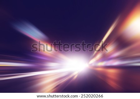 Abstract image of speed motion on the road at night time. Royalty-Free Stock Photo #252020266