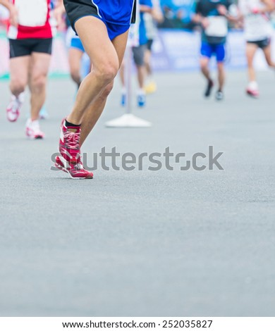 Group of marathon runners compete in the race #252035827