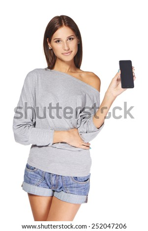 Young woman showing mobile cell phone with black screen over white background #252047206