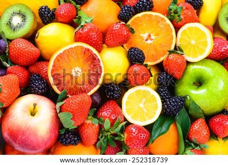 Fresh fruits background. Juicy fruits. Royalty-Free Stock Photo #252318739