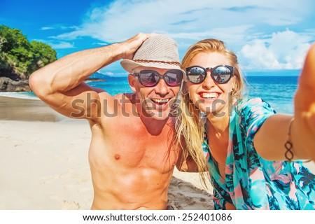 couple taking selfie on a beach