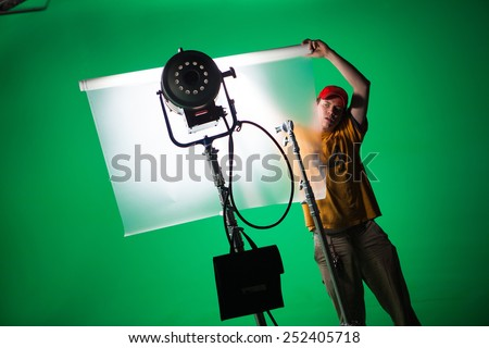 film crew working in green screen studio