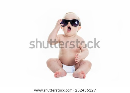 Portrait of cute toddler wearing sunglasses. Isolated on white. #252436129