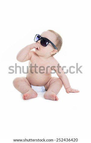 Portrait of cute toddler wearing sunglasses. Isolated on white. #252436420