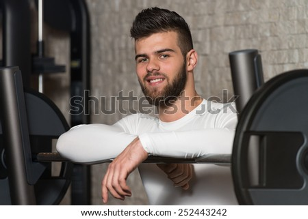 Portrait Of A Physically Fit Young Man Resting In A Health Modern Club #252443242