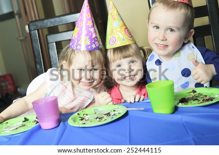 A children birthday with the kid eat cake.