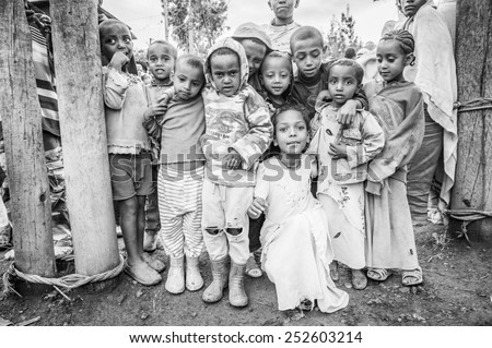 OMO, ETHIOPIA - SEPTEMBER 21, 2011: Unidentified Ethiopian children in the street. People in Ethiopia suffer of poverty due to the unstable situation #252603214
