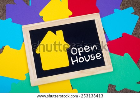 Yellow home sign on the blackboard: Open house