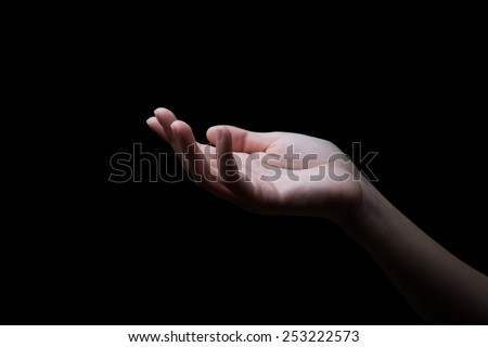 woman hands palms up over black background #253222573