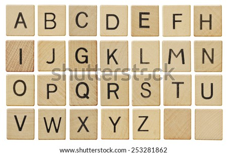Alphabet letters on wooden letter pieces, isolated on white. Royalty-Free Stock Photo #253281862