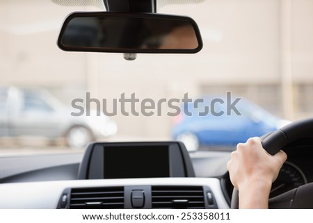 Close up of a rear view mirror in her car Royalty-Free Stock Photo #253358011
