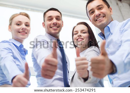 business, teamwork, success, people and gesture concept - smiling business team showing thumbs up in office #253474291