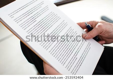Reading documents, closeup Royalty-Free Stock Photo #253592404