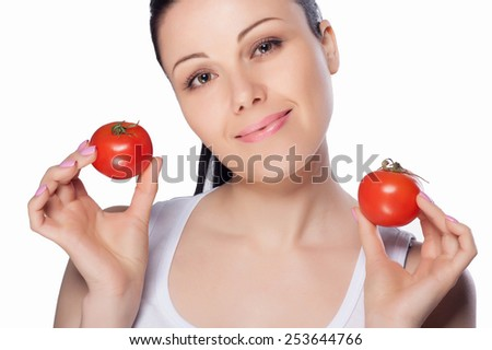 Beautiful close-up portrait of young woman with tomato. Healthy food and vegetables concept. Skin care and beauty. Vitamins and minerals. #253644766