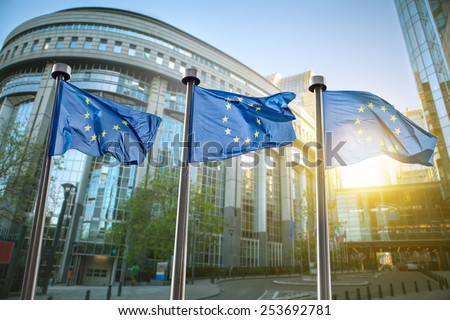 European union flag against parliament in Brussels, Belgium Royalty-Free Stock Photo #253692781