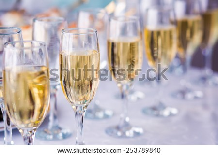 Beautiful line of different colored cocktails with smoke on a open air party, tequila, martini, vodka, and others on decorated catering bouquet table on open air party  #253789840