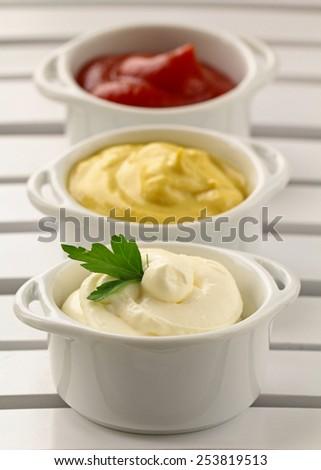 mustard, ketchup and mayonnaise - three kinds of sauces #253819513