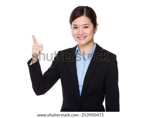 Businesswoman with thumb up #253900471