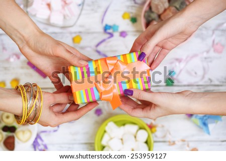 Female hands holding gift close-up #253959127