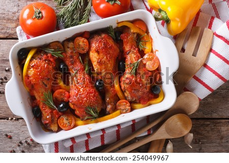 Chicken legs baked in tomato sauce with olives close-up. horizontal view from above #254049967