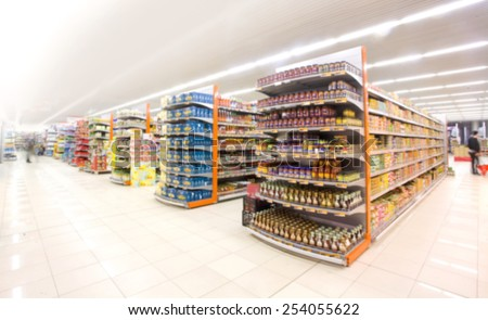 Supermarkets, lens blur effect. Royalty-Free Stock Photo #254055622