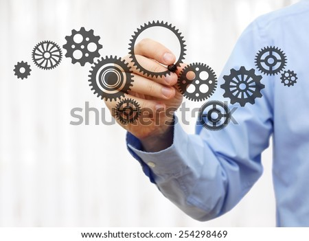 engineer draws a chain sprockets. Technology and industry concept #254298469