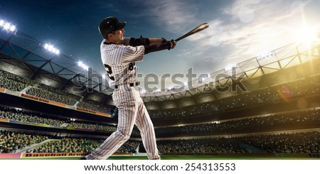 Professional baseball player in action on grand arena #254313553