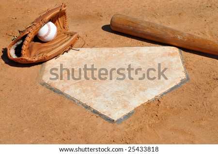 Baseball, glove, and bat on home plate. #25433818