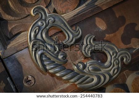decorative door handle in the shape of a fish