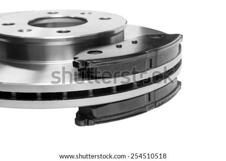 brake pads adjacent to the brake disc Royalty-Free Stock Photo #254510518