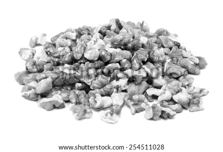 Chopped walnuts, isolated on a white background - monochrome processing #254511028