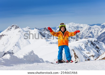 Happy boy skiing on Sochi ski resort, Russia #254661466