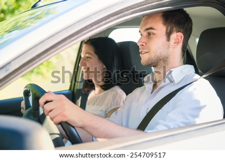 Happy time together - couple in car, man is driving #254709517