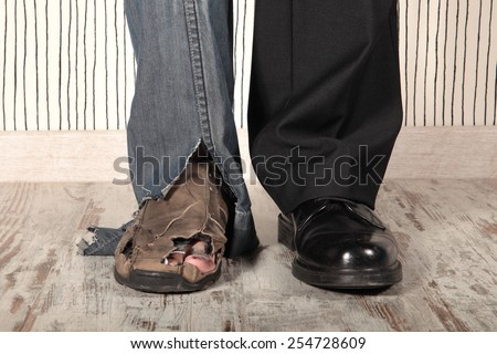 concept of rich and poor in a person Royalty-Free Stock Photo #254728609