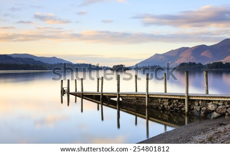 Derwentwater Landing Stage.  Evening light on Ashness Gate landing stage.  The landing stage at Ashness Gate is on the banks of Derwentwater, Cumbria in the English Lake District national park. #254801812
