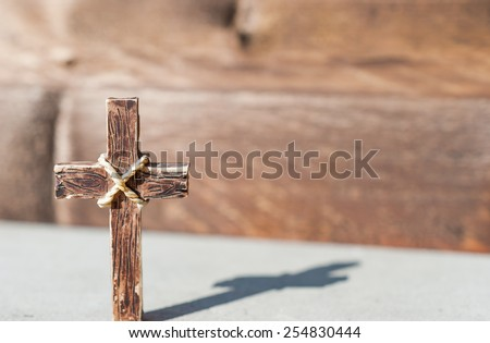 Holy cross in a sunny day and beautiful shadow of the cross