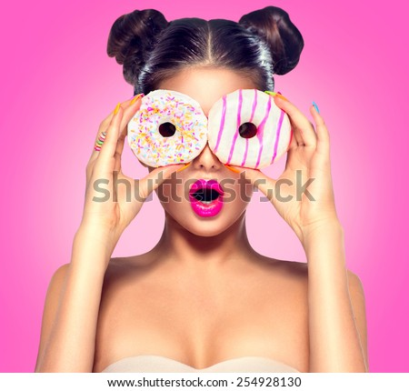 Beauty fashion model girl taking colorful donuts. Funny joyful woman with sweets, dessert. Diet, dieting concept. Junk food, Slimming, weight loss Royalty-Free Stock Photo #254928130