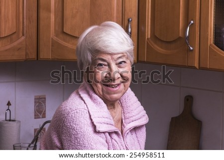 Old woman smiling in kitchen #254958511