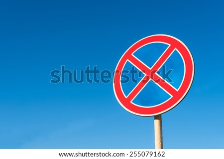"Road sign ""no parking"" under blue sky"