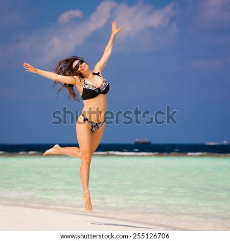 beautiful  sexy young fun smiling woman with sunglasses and bikini jump in romantic  atoll island paradise luxury  resort  amazing  fresh  freedom snorkel adventure #255126706